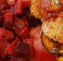 Bbq seitan with acorn squash; spiced beets and carrots close up