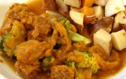 Tamari tempeh with broccoli in kabocha squash sauce; roasted potatoes and butternut squash in red onion broth close up