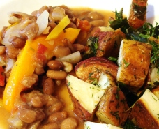 Pinto beans and yellow and orange bell peppers with capers and mustard; roasted red and russet potatoes with collards and dill