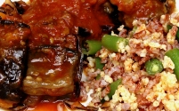 Roasted eggplant in squash-tomato sauce with red cabbage and fennel seeds; madagascar pink rice and millet pilaf with green beans