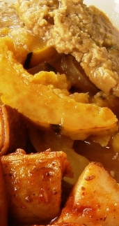 Seitan and delicata squash in picante sauce; patates braves Sidebar